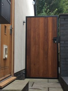"""<MF> (""""Garden Gate in our """"York"""" design. Deep metal framed with the finest hand selected iroko hardwood. Osmo oil finish with black powder coated gate frame. Fitted door handle and lock. Garden Entrance, Garden Doors, Entrance Gates, House Entrance, Patio Doors, Wooden Garden Gate, Metal Garden Gates, Wooden Gates, Wooden Barn"""