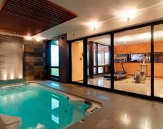 Home Workout Room Design, Pictures, Remodel, Decor and Ideas - pretty cool workout room with an indoor pool. Looks like it also has a skylight.if not, I would add one! Dream Home Gym, Best Home Gym, Workout Room Home, Workout Rooms, Pool Workout, Home Gym Design, House Design, Spa Design, Piscina Spa