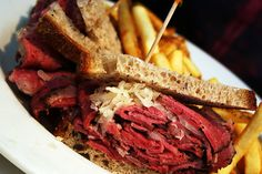 Pastrami in New York City ::: To get a true New York experience, eat a Pastrami Sandwich. Eastern European and Jewish immigrants brought over the dish and it's still a favorite today. The meat goes through its share of work while it's brined, smoked, boiled and steamed with seasonings including coriander and sugar, before being served on rye bread with mustard. Don't ask for mayonnaise if you want to blend in and avoid the dirty looks.    Try it at: Katz Delicatessen. The average price is…