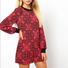 ASOS shift style Romper!  Eye catching print! Red and black, trippy kaleidoscope-esque print romper!  Romper has somewhat of a shift style silhouette.  Print is eye catching and makes a statement.  This is an ASOS brand-- US size 6, UK 10.  Romper is long sleeved, with rib knit cuffs and collar.  Material does not provide stretch except at cuffs and collar.  Fits true to size! ASOS Dresses Mini