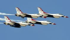Four U.S. Air Force Thunderbird F-16 Fighting Falcons zoom by the visitors of the Lightning in the Desert Air Show #USNavy