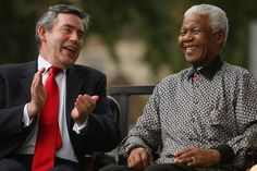 In This Photo: Gordon Brown, Nelson Mandela  British Prime Minister Gordon Brown applauds ex-South African President Nelson Mandela during a statue unveiling ceremony in Nelson Mandela's honour at Parliament Square on August 29, 2007 in London, England. The statue depicting Nelson Mandela delievering a speech, by sculptor Ian Walters, is nine-feet (2.7-metres) high, made of bronze and faces the Houses of Parliament.