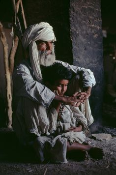 Steve McCurry...This copliments the other photo, with the boy asleep. What of several things is this man thinking. Such a scene.