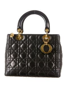 d9d775dbc3d23a Black cannage leather Christian Dior Lady Dior Bag with gold-tone hardware,  logo charms, interior zipped wall pocket and top zip closure.