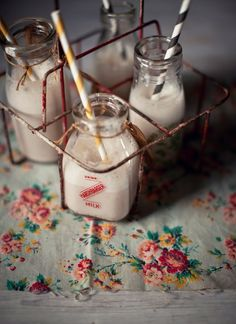 milk bottles in different sizes, these would look really cute in a wedding