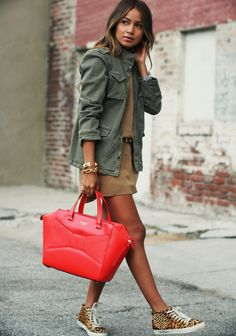 For a fantastic and fresh military style, copy Julie Sarinana and wear a pair of bright and colorful sneakers with your look! Grab a bright bag to create further contrast.