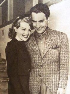 Lana Turner and Artie Shaw photographed on the steps of his Beverly Hills home hours after their surprise Las Vegas wedding on February 13, 1940 (following their first date).