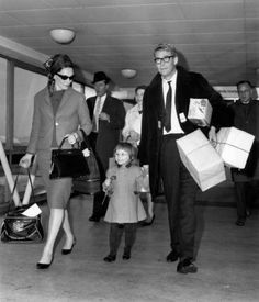 Peter O'Toole and his wife, Welsh actress Sian Phillips, arrive at London Airport on March 14, 1964