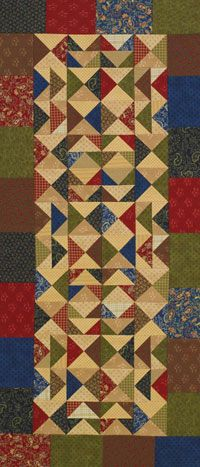 Careful color placement of rich navy, olive, brown, and red is key to creating this three-block table runner of hourglass and Flying Geese units.