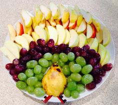 Fruit tray Thanksgiving turkey style. I used pear half for body, fruit roll up for feet, then honey with small m&m's for eyes and nose and a cranberry for giblet. Cut fruit used green and red seedless grapes, two kinds if apples and fresh pair. Served fruit dip along with it.