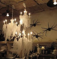 This one really has an eerie feel with the cheesecloth draped over the chandeliers.