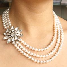 That could be a brooch and a string of pearls. Hmmm....