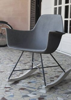 Our sophisticated Hauteville Concrete Rocking Chair designed by Henri Lavallard Boget for Lyon Beton draws its inspiration from the iconic mid-century design but with a modern twist.