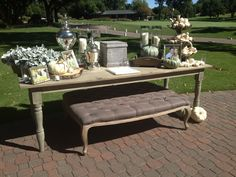 The Farm Dining Table and Louis Tufted Brown Ottoman making this more than just a regular welcome table! Both ready for event rental with Perch Event Decor - perchdecor.com