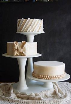 Three round wedding cakes on different leveled stands. Found on www.bridebug.com