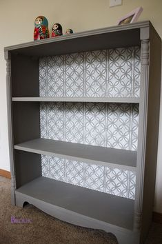 stenciledbookcase6. Liking this! I've got an old mahogany bookcase which is an ugly colour but its shape is beautiful and I've had it since I was small so this looks like a great project to do. Paint it and make it pretty!