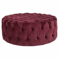 Button-tufted ottoman with Bordeaux-colored cotton upholstery.
