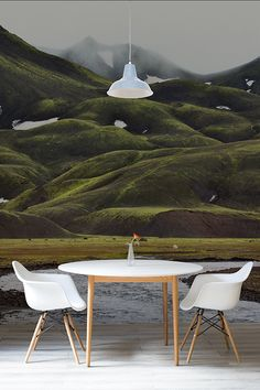 Bring some Icelandic cool into your home with this beautiful landscape wall mural. A misty grey sky meets entwining green hills that make up this enchanting mountain scene. Perfect for dining room spaces looking for a totally unique aspect.
