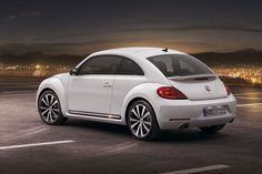 The new volkswagon beetle! - Really want...:)  So it would be Bug's first car when she is old enough to drive!