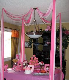 I like how the streamers hang feom the center to the corners of the food table. Maybe add some balloons :) Pink Party - pretty and simple theme Pink Parties, Slumber Parties, First Birthday Parties, First Birthdays, Rainbow Parties, Sleepover, Streamer Decorations, Party Streamers, Birthday Decorations