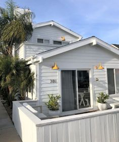 Using a bright yellow porcelain finish for our wall lights is an easy way to transform or revamp a house's curb appeal. Exterior Lighting, Outdoor Lighting, Outdoor Decor, Outdoor Settings, Finding A House, Light Shades, Curb Appeal, Farmhouse Style, Shed