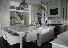 What a fantastic kitchen! Designed by Erika Powell of Urban Grace Interiors, I think it's the symmetry here that is really appealing to me. Not only gorgeous, the room is so versatile and family friendly too. I love that it's its own space, yet connected to the other rooms with the windows.