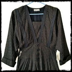 """Vintage Black & Gold Dress A wonderful vintage Nina Piccolino dress with 3\4length dolman style sleeves. Waist has back elastic and front faux cummerbund has 4 covered buttons. Measures shoulders 17""""; waist 27""""- 32""""; length from Bach of neck 48"""". No size or content labels. Vintage Dresses Midi"""