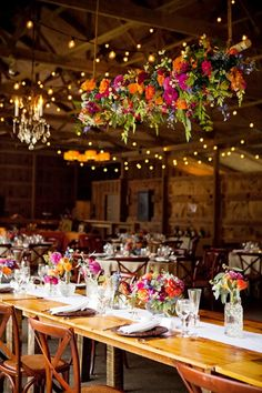 Wedding Flowers 038 Bouquets Wedding Flowers 038 Bouquets 1 Wedding colors Brides The Full Bouquet created a colorful floral chandelier filled hellip Chandelier Wedding Decor, Wedding Reception Lighting, Romantic Wedding Receptions, Flower Chandelier, Rustic Wedding Centerpieces, Wedding Table, Wedding Decorations, Wedding Ideas, Trendy Wedding
