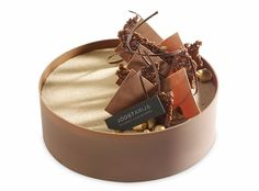 Картинки по запросу The perfect harmony of smooth and rich dark chocolate mousse, light chocolate genoise laced with dark rum, with a delicately crisp hazelnut fuellitine and almond succes biscuit.