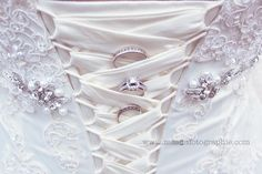 wedding rings in corset dress
