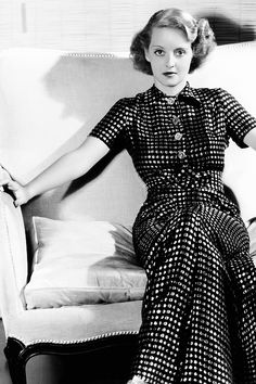 Bette Davis, a young American movie star in traditional dress.  ak