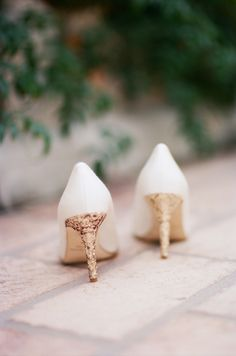 White + gold Kate Spade wedding shoes