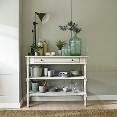 Drawing on a palette of fresh greens, stylist Sally Conran has created a series of perfect country-style summer dining rooms in our July issue | Photograph Chris Everard | Homes & Gardens | http://www.hglivingbeautifully.com/2016/06/15/finishing-touches-garden-room-style/