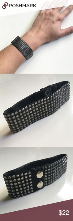 "Studded Bracelet Black, studded, flexible bracelet. Double snap closure. About 8"" long when open and laid out. Lightweight and versatile. Lined on the inside with a thin felted material. Studs are a plastic material, not metal. Worn a few times and has sat in my jewelry drawer ever since. Great condition. Originally from Off 5th (Saks 5th Ave outlet). Jewelry Bracelets"