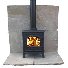 Mint Fossil - Natural Sandstone Hearth Tiles - I like this: it doesn't contrast too much with black of stove and isn't too dark either..