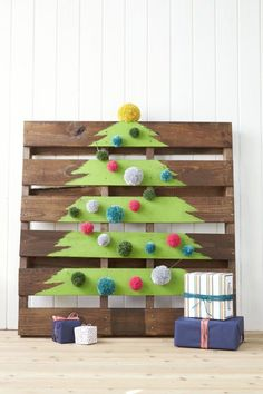 Paint a tree on a shipping crate (you can find 'em forcheap on eBay), and embellish the slats withpom-poms.