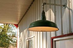 old gas station lights installed outside a barn
