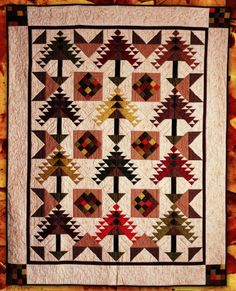 The colors of the changing leaves of Autumn grace this Native-American-inspired design from Lynn Dash, isn't it beautiful? Lynn created this project using the Jinny Beyer Palette collection from RJR, and they are providing it for you as a free download. This is a great project for experienced quilters looking for some Fall fun with triangles. http://www.freequiltpatterns.info/free-pattern---autumn-splendor-quilt-by-lynn-dash.htm