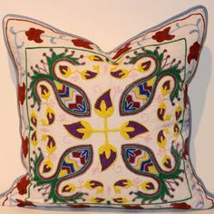 One day I hope to have the embroidering skills to accomplish something like this!  Filling Spaces  Hand-Embroidered Indian Pillows