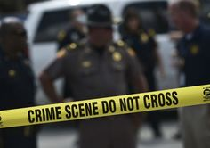 Police were shot at in four US cities resulting in the death of one officer and three injured