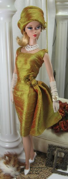 A vintage style sheath cut from chartreuse silk dupioni shot with red, fully lined, and features a scoop neck front and back and side drape