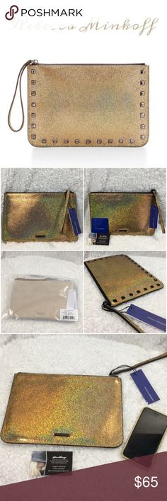 Rebecca Minkoff glitter Kerry🌟 Gorgeous new with tags gold Kerry glitter large pouch. Leather. See dimensions above in photo. iPad fits with ease. Made with high quality, genuine leather. Differences in color shading, marks and grain are inherent characteristics of the lush, natural leathers chosen to create the RM collection. This means no two pieces are the same, enabling each person to own a one of a kind version of this fabulous bag!!!!🌟This is a strong statement piece❤️ Rebecca…