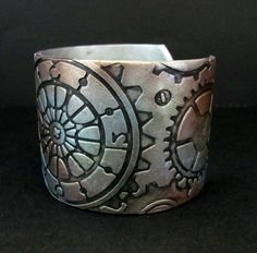 Love the metallic colors in this cuff by PolymerPlayin on Etsy.