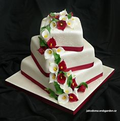 Calla Lily Wedding Cake — Square Wedding Cakes - eash layer slightly offset, flowers running down the side of the corners