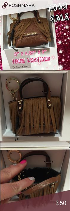 """Calvin Klein Fringed Leather Keychain Purse NWT ♥️ This is too cute! It is a keychain """"purse"""" made with genuine leather with suede fringe in the front. The hardware and logo are gold tone. This is perfect for those last minute errands you need to run and only need a few things! It measures 3"""" x 4.25"""" x 2"""". Looks and functions like a real bag just hooked to your keys! Thank you! Calvin Klein Bags Wallets"""