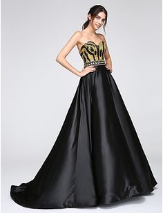 This is such a gorgeous dress made with satin with sequins. Tip: wear it with some sleeves for an even more elegant look! Repin if you like it.