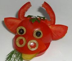 Bull - made from tomato, olives & pickle.  Would be a cute garnish on a plate of grilled hamburgers