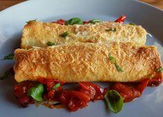Homemade cannelloni gevuld met spinazie, ricotta en gecrushte hazelnoten en een saus van tapastomaatjes, look, basilicum en parmigiano