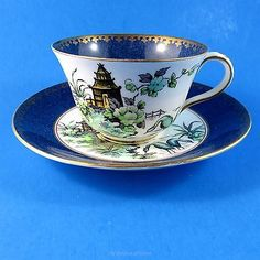Painted Oriental Scene Crown Staffordshire Teacup and Saucer Set