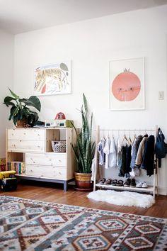 Kids' Bedroom Inspiration. Large framed prints - could frame kids' own artwork. Fluffy rug. Large patterned floor rug.